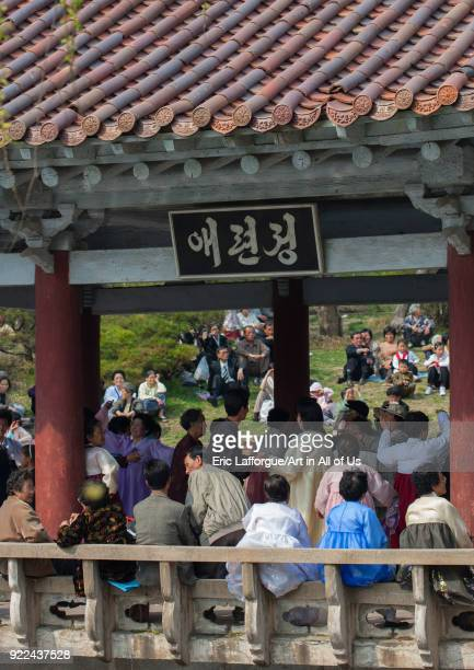 North Korean people dancing in a pavillon for the day of the sun which is the birth anniversary of Kim Ilsung Pyongan Province Pyongyang North Korea...