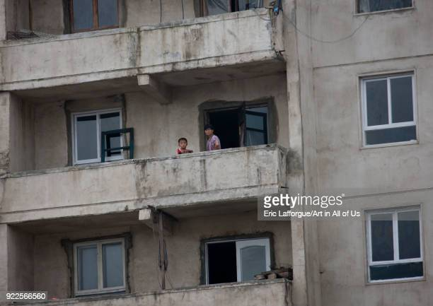North Korean people on the balcony of an apartement North Hwanghae Province Kaesong North Korea on September 11 2011 in Kaesong North Korea