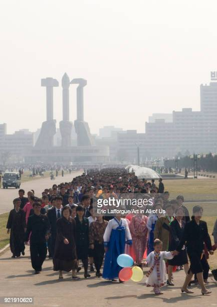 North Korean people queueing to see the international Kimilsungia and Kimjongilia festival Pyongan Province Pyongyang North Korea on April 15 2008 in...
