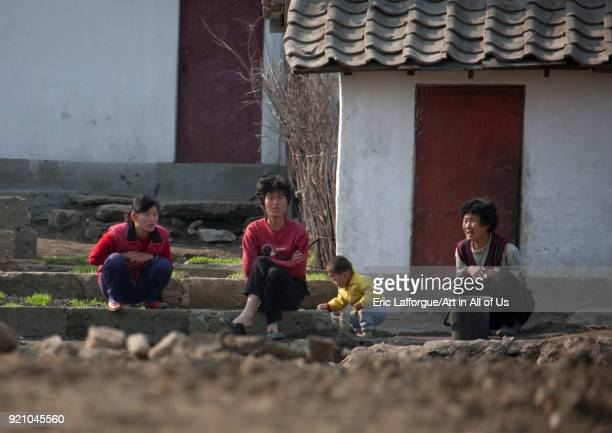 North Korean people sit in front of their house, Pyongan Province, Pyongyang, North Korea on May 2, 2010 in Pyongyang, North Korea.