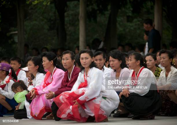 North Korean people squatting and waiting to visit the Kim il Sung Mangyongdae native house Pyongan Province Pyongyang North Korea on September 9...