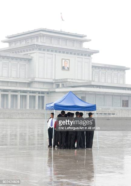 North Korean people under the rain in Kumsusan palace of the sun that serves as the mausoleum for Kim Ilsung and Kim Jongil Pyongan Province...