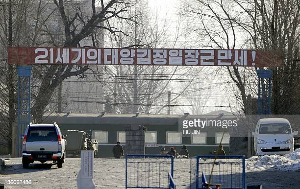 North Korean people wait at a train station along the bank of the Yalu River in the North Korean town of Sinuiji on December 22 in this picture taken...