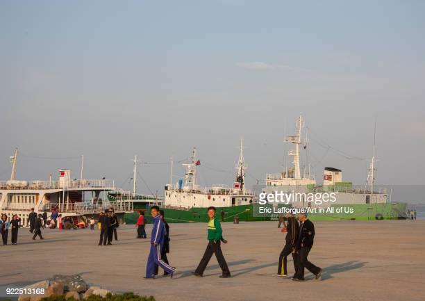 North Korean people walking in the harbour Kangwon Province Wonsan North Korea on May 1 2010 in Wonsan North Korea
