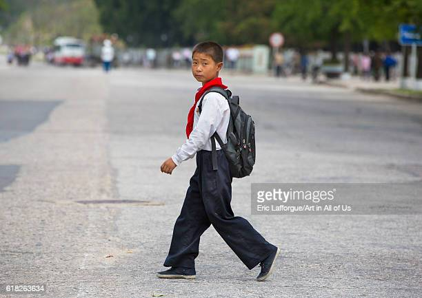 North korean pioneer kid crossing a road kaesong North Korea on September 7 2012 in Kaesong North Korea