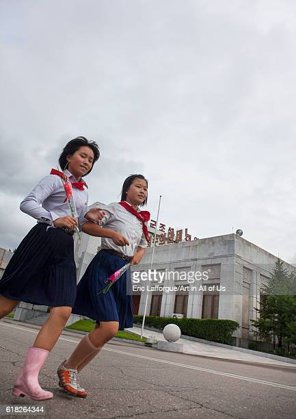 North korean pioneers going to pay respect to the dear leaders at mansudae art studio pyongyang North Korea on September 8 2012 in Pyongyang North...