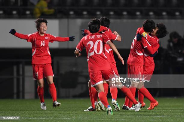 North Korean players celebrate the East Asian Champions following their 2-0 victory in the EAFF E-1 Women's Football Championship between Japan and...