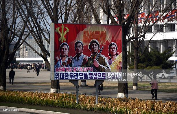 A North Korean poster is seen in the streets of Pyongyang on April 11 2012 North Korea is counting down to the 100th anniversary of its founder's...
