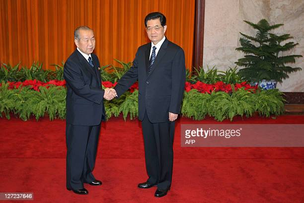 North Korean Prime Minister Choe Yong Rim shakes hands with China's President Hu Jintao at the Great Hall of the People on September 27, 2011 in...