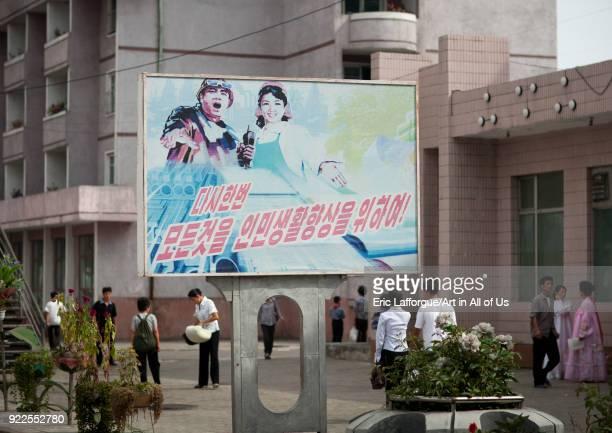 North Korean propaganda billboard with dull colors in the street Pyongan Province Pyongyang North Korea on September 10 2011 in Pyongyang North Korea