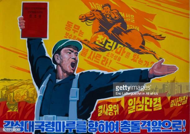 North Korean propaganda poster depicting a worker holding a red book, Pyongan Province, Pyongyang, North Korea on December 6, 2017 in Pyongyang,...