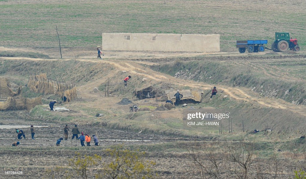 North Korean residents in a showcase village in the demilitarised zone make preparations for farming on April 23, 2013. Tensions simmer along the world's last Cold War frontier after weeks of hostile threats from North Korea and its preparations for potential missile launches.
