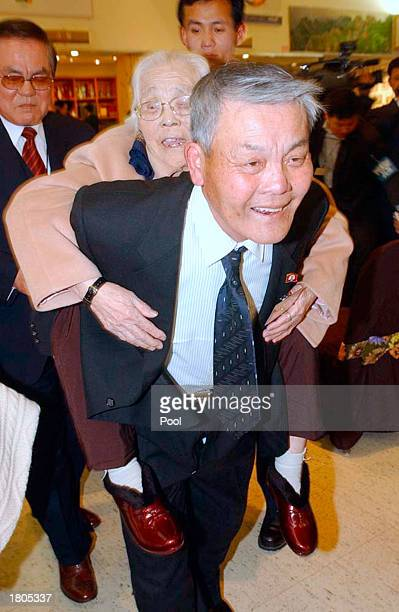 North Korean Rim DongKyu carries his South Korean mother Kim KumNam during the sixth round of reunions of family members from the two Koreas...