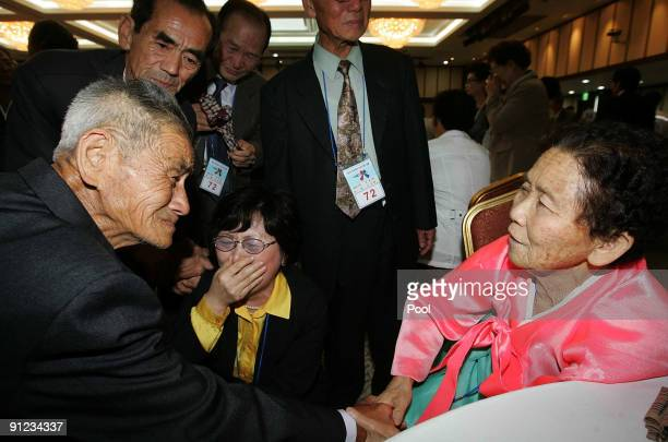 North Korean Roh JoonHyun meets with his South Korean relatives during a separated family reunion meeting at the Mount Kumgang resort on September 29...