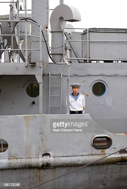 North Korean sailor about the captured American ship the USS Pueblo along the Taedong River on September 9 2010 in Pyongyang North Korea