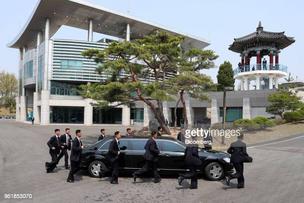 North Korean security escort a vehicle carrying Kim Jong Un North Korea's leader following the morning session of the interKorean summit in the...