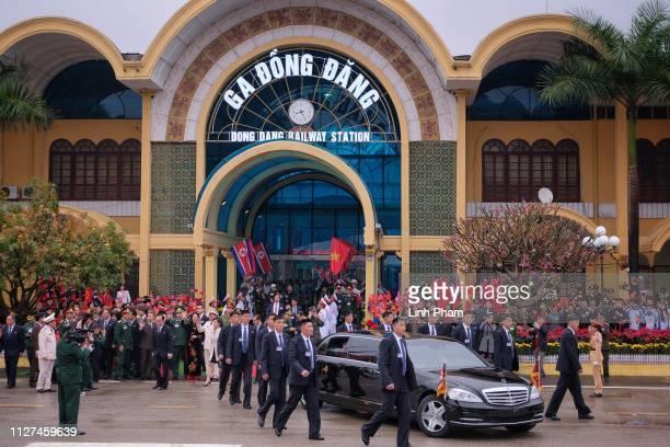North Korean security escorting a car carrying Kim Jongun at Dong Dang railway station near the border with China on February 26 2019 in Lang Son...