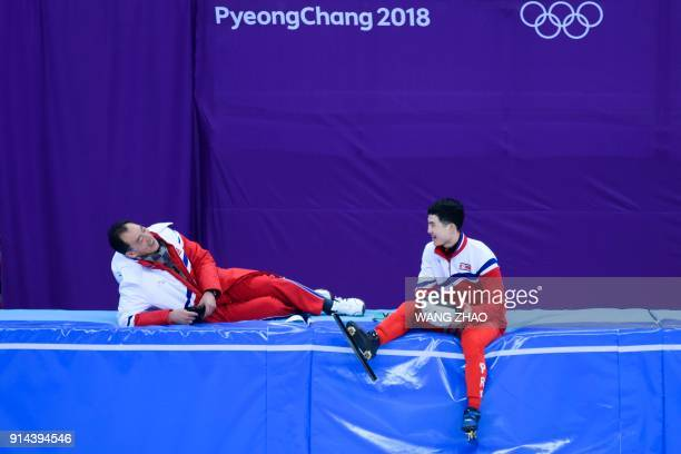 North Korean short track speed skater Jong Kwang Bom talks with his coach during a training session at the Gangneung Ice Arena in Gangneung prior to...