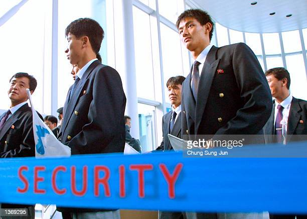 North Korean soccer players holding unification flags arrive at the Incheon International Airport September 5 2002 in Incheon South Korea A 49member...