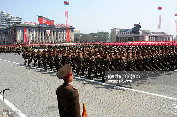 North Korean solders march during a military parade to mark 100 years since the birth of the country's founder Kim IlSung in Pyongyang on April 15...