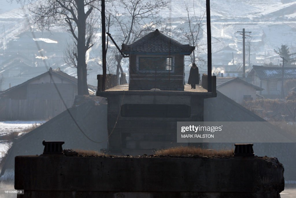 A North Korean soldier guards a bridge bombed in 1951 by the US Air Force between the North Korean town of Ch'ongsudong-Chung-ni and the Chinese town of Hekoucun on February 9, 2013. US Secretary of State John Kerry warned that North Korea's expected nuclear tests only increase the risk of conflict and would do nothing to help the country's stricken people. The country has vowed to carry out a third nuclear test soon, and concerns have been raised over the type of fissile material used in the device. AFP PHOTO/Mark RALSTON