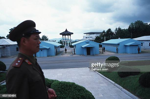 North Korean soldier in Panmunjom on the 38th parallel in the DMZ or demilitarised zone This 25 mile wide 156 mile long no man's land separates North...