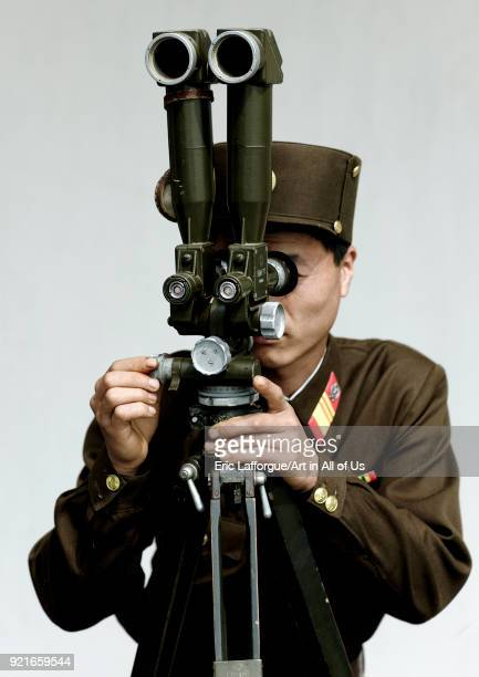 North Korean soldier looking south Korea with binoculars at the Demilitarized Zone, North Hwanghae Province, Panmunjom, North Korea on May 20, 2009...