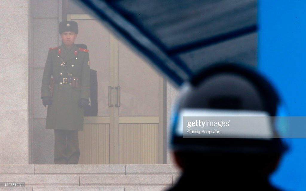 A North Korean soldier looks at South Korea across the Korean Demilitarized Zone (DMZ), on February 27, 2013 in Panmunjom, South Korea. North Korea confirmed it had successfully carried out an underground nuclear test on February 12, as a shallow earthquake with a magnitude of 4.9 was detected by several international monitoring agencies.