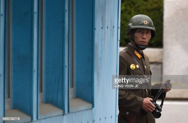 A North Korean soldier looks at the South side while US Vice President Mike Pence visits the truce village of Panmunjom in the Demilitarized Zone on...
