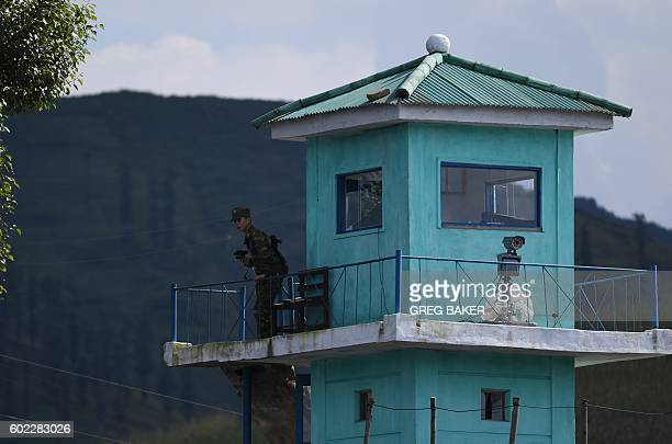 A North Korean soldier mans a guard post near the North Korean town of Sinuiju opposite the Chinese border city of Dandong on September 11 2016 North...
