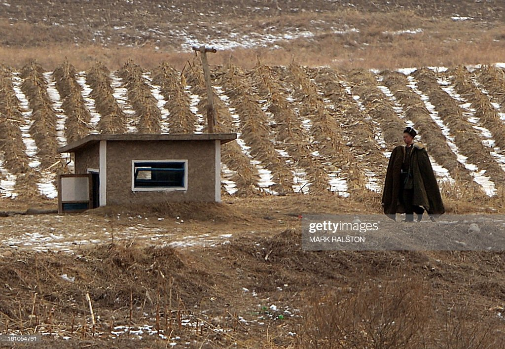 A North Korean soldier patrols the border area near the Chinese town of Dujiagou on February 9, 2013. US Secretary of State John Kerry warned that North Korea's expected nuclear tests only increase the risk of conflict and would do nothing to help the country's stricken people. The country has vowed to carry out a third nuclear test soon, and concerns have been raised over the type of fissile material used in the device. AFP PHOTO/Mark RALSTON