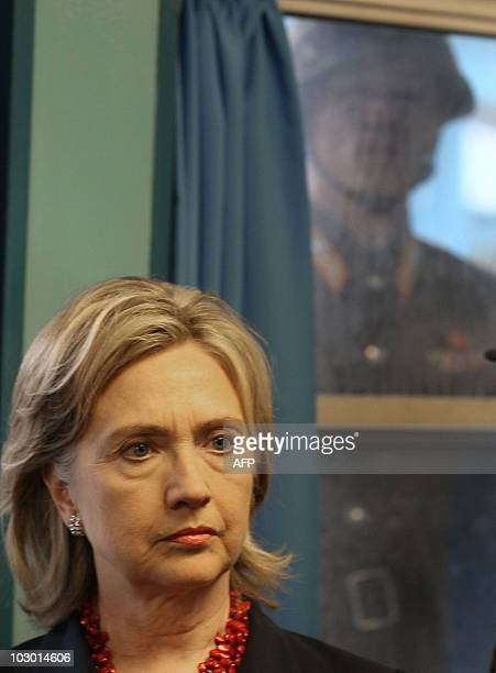 North Korean soldier peers in through a window at US Secretary of State Hillary Clinton during a visit at a UN truce village building that sits on...