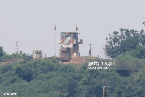 North Korean soldier stands at the check point seen from South Korea near the demilitarized zone on June 16 2020 in Paju South Korea North Korea's...