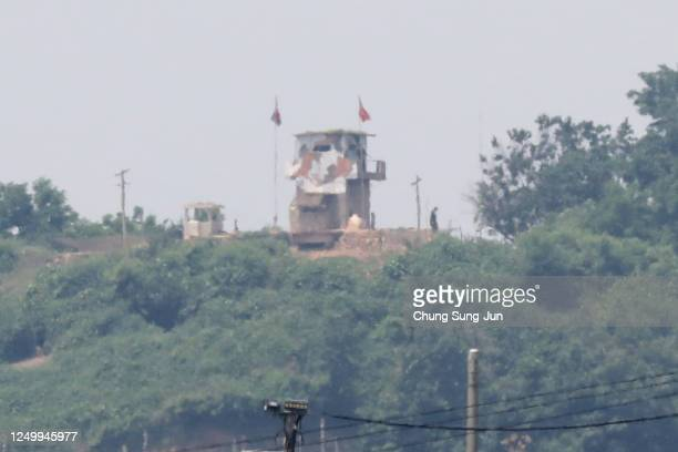 North Korean soldier stands at the check point seen from South Korea, near the demilitarized zone on June 16, 2020 in Paju, South Korea. North...