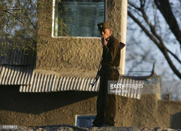 North Korean soldier stands guard on the bank of the Yalu River in the North Korean border city of Sinuiju on October 20 2006 in this picture taken...