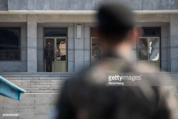 A North Korean soldier stands guard outside the Panmungak building on the North Korean side of the truce village of Panmunjom in the Demilitarized...