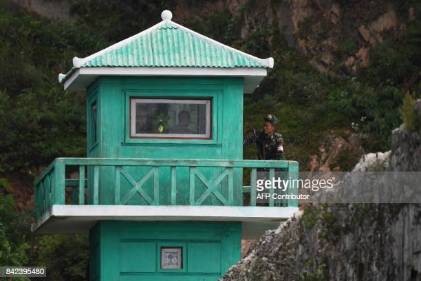 A North Korean soldier stands on a guard post on the bank of the Yalu river near the North Korean town of Sinuiju opposite the Chinese border city of...