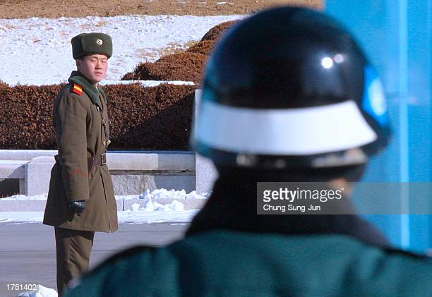North Korean soldier watches South Korean soldiers January 29 as he stands guard at Panmunjom the site of the signing of the 1953 armistice which...