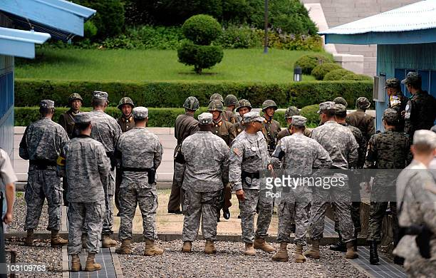North Korean soldiers and US soldiers stand guard during the 57th anniversary of signing the ceasefire agreement ceremony on July 27 2010 in...