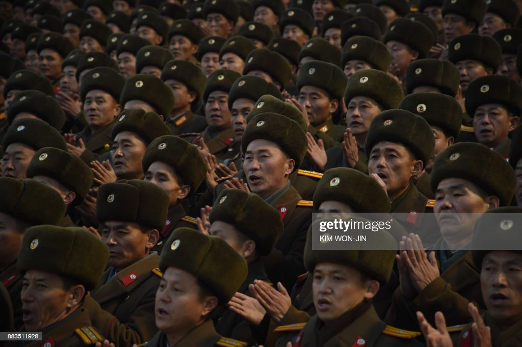 North Korean soldiers attend a mass rally to celebrate the North's declaration on November 29 it had achieved full nuclear statehood, on Kim Il-Sung Square in Pyongyang on December 1, 2017. North Korea's leader Kim Jong-Un declared the country had achieved a 'historic cause' of becoming a nuclear state, its state media said on November 29, after the country tested an intercontinental ballistic missile earlier in the day. / AFP PHOTO / Kim Won-Jin