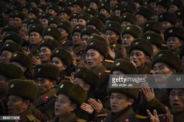 North Korean soldiers attend a mass rally to celebrate the North's declaration on November 29 it had achieved full nuclear statehood on Kim IlSung...