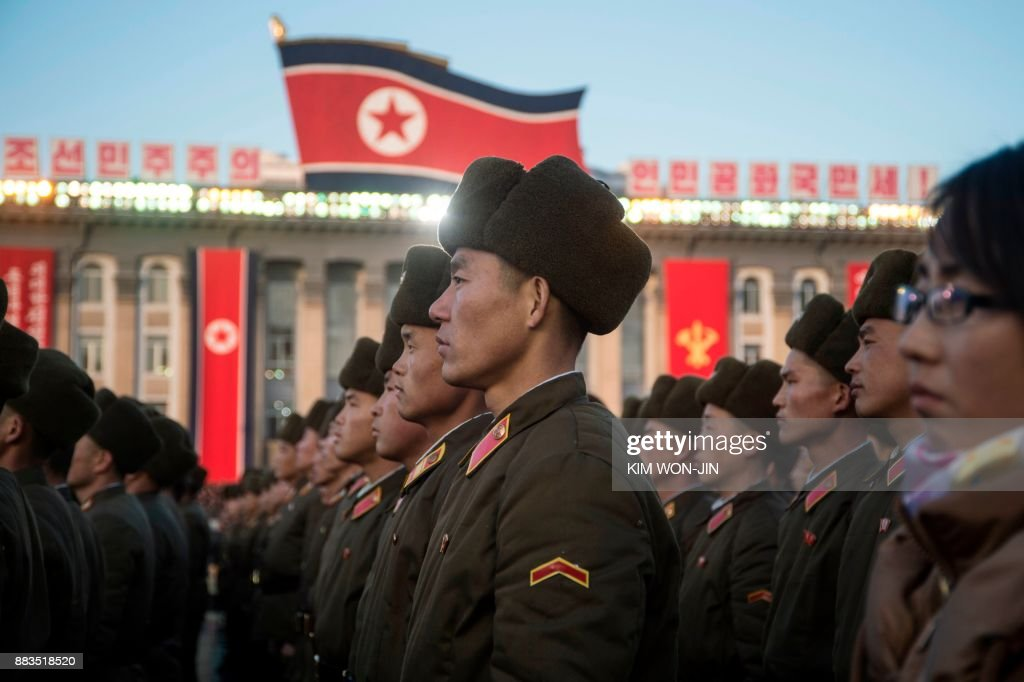TOPSHOT - North Korean soldiers attend a mass rally to celebrate the North's declaration on November 29 it had achieved full nuclear statehood, on Kim Il-Sung Square in Pyongyang on December 1, 2017. North Korea's leader Kim Jong-Un declared the country had achieved a 'historic cause' of becoming a nuclear state, its state media said on November 29, after the country tested an intercontinental ballistic missile earlier in the day. / AFP PHOTO / Kim Won-Jin
