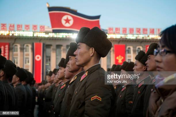 TOPSHOT North Korean soldiers attend a mass rally to celebrate the North's declaration on November 29 it had achieved full nuclear statehood on Kim...