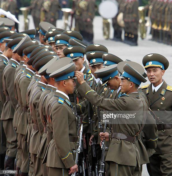 North Korean soldiers get ready to parade in front of South Korean President Roh Moo-Hyun and North Korean leader Kim Jong-Il for a welcoming...