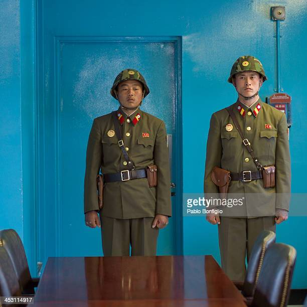 CONTENT] North Korean soldiers guarding the door to South Korea in the Joint Security Area part of the Korean Demilitarized Zone in April 2012