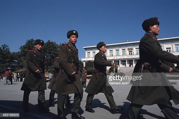 North Korean soldiers in Panmunjom on the 38th parallel in the DMZ or demilitarised zone The 25 mile wide 156 mile long DMZ is a no man's land...