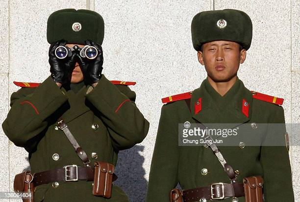 North Korean soldiers look at South Korea across the Korean Demilitarized Zone on December 22 2011 in Panmunjom South Korea US and South Korean...