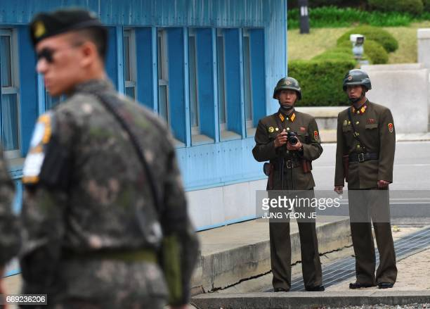 North Korean soldiers look at the South side while US Vice President Mike Pence visits the truce village of Panmunjom in the Demilitarized Zone on...