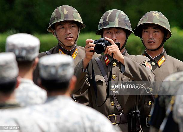 North Korean soldiers look at US soldiers during the 57th anniversary of signing the ceasefire agreement ceremony on July 27 2010 in Panmunjom South...