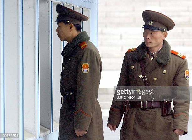 North Korean soldiers look inside a conference room while Hungarian Prime Minister Ferenc Gyurcsany visits the border village of Panmunjom 11 March...